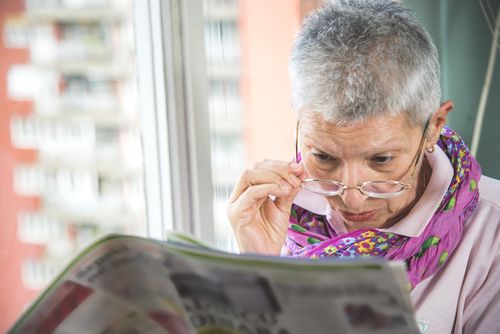 Elderly woman researching Cataract Information