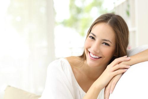 Woman smiling looking at camera.