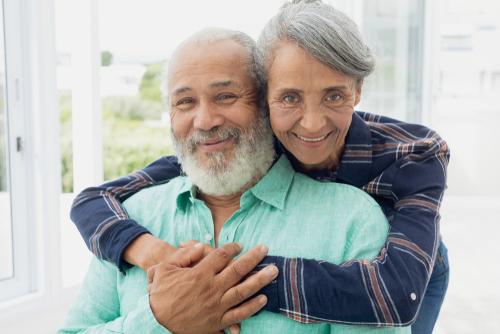 Elderly couple celebrating after cataract surgery