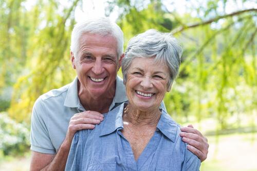 Older couple celebrating after cataract surgery